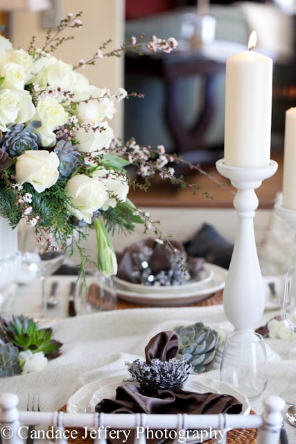 winter wonderland table setting with fresh white roses and succulents, pillar candles