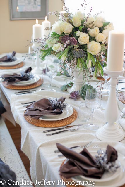 Winter table setting with white roses and succulents