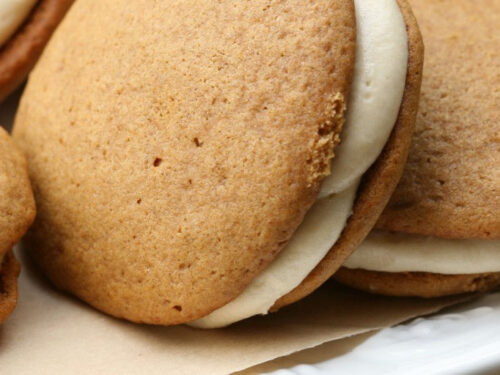 Pumpkin Whoopie pies on a white footed cake dish