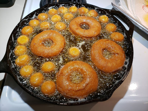 frying doughnuts in a cast iron skillet