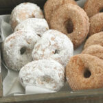 cake donuts leaned against each other in reclaimed wood box