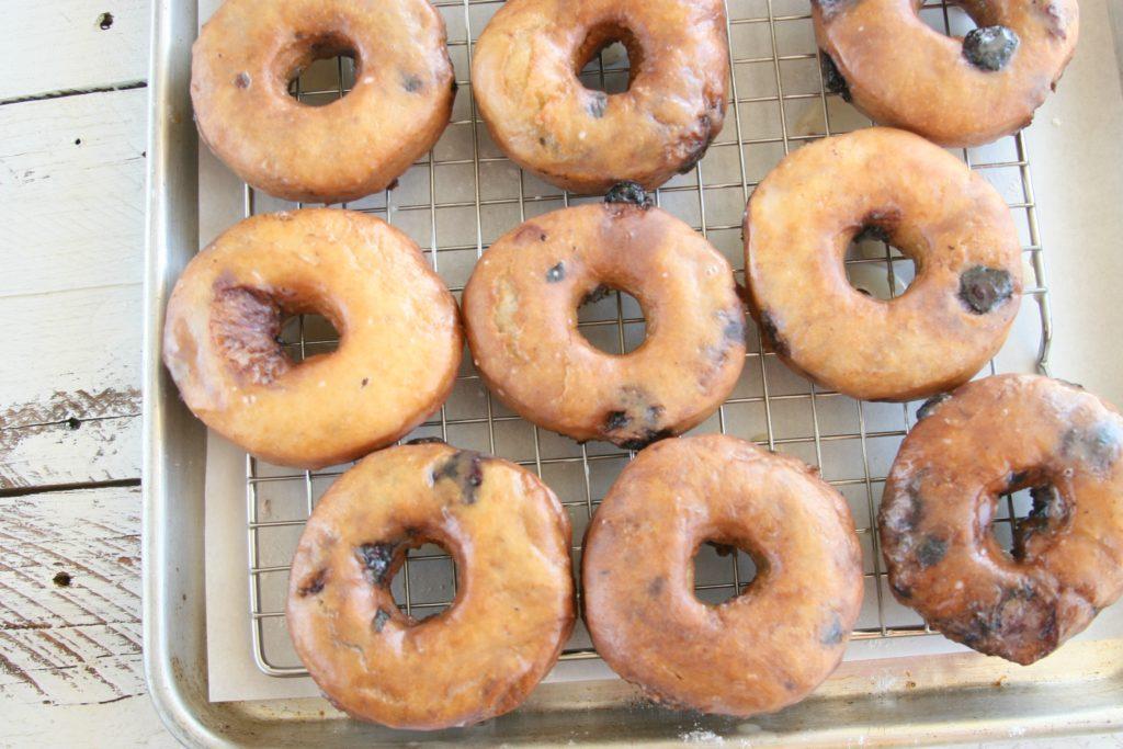 blueberry cake doughnuts glazed drying on baking rack