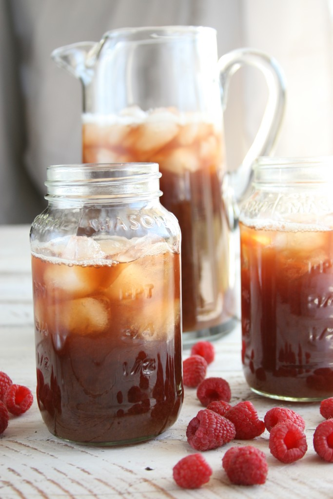Raspberry Iced tea in glass pouring pitcher