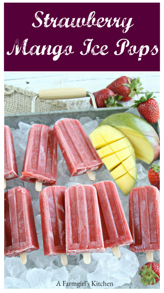 Homemade strawberry mango ice pops sitting in a galvanized tray of ice cubes
