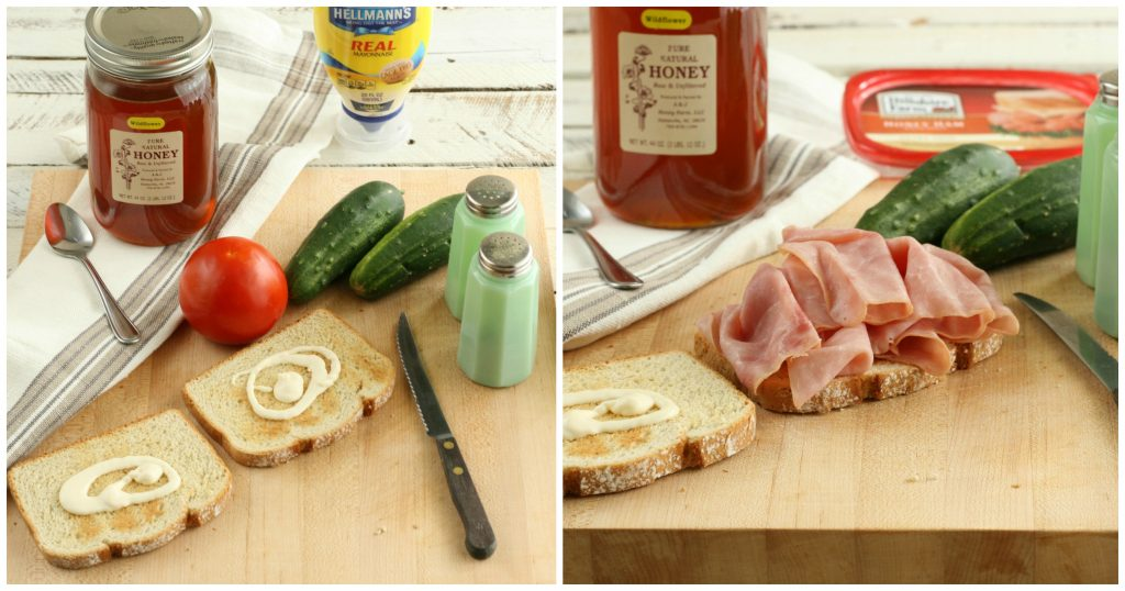 homemade ham sandwich being made on a wooden cutting board