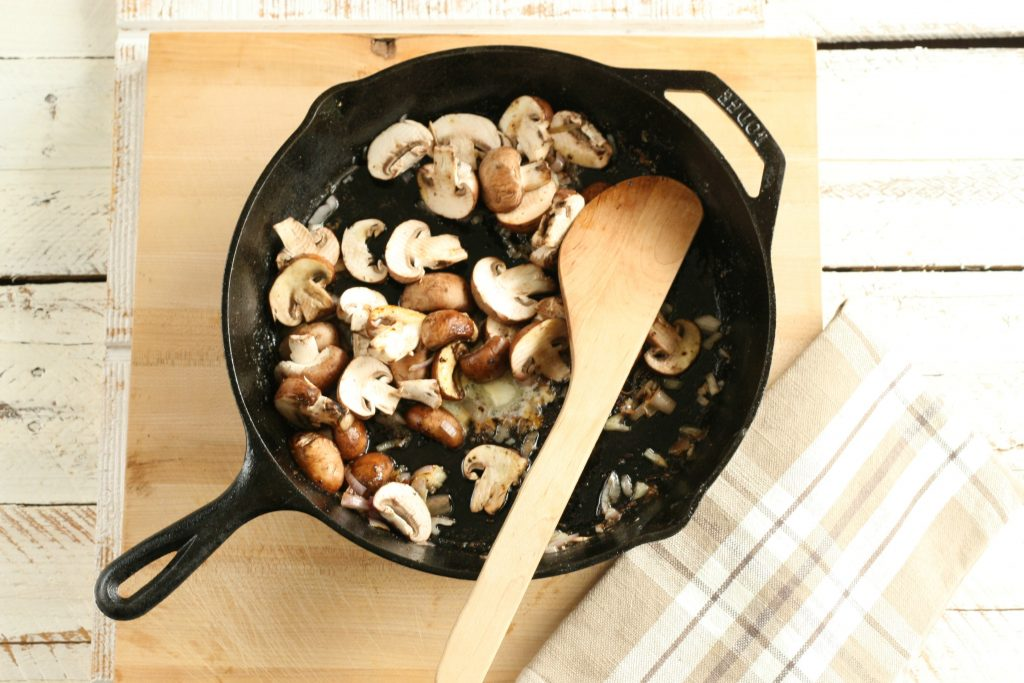 mushrooms browing in a cast iron skillet