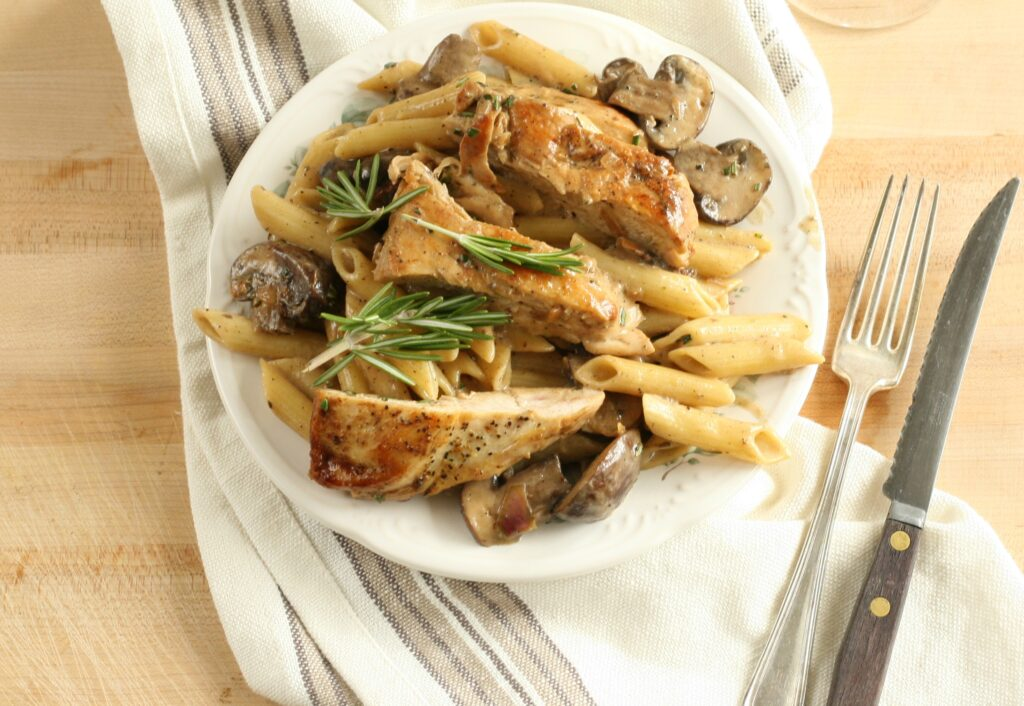 lemon rosemary chicken pasta on white serving plate