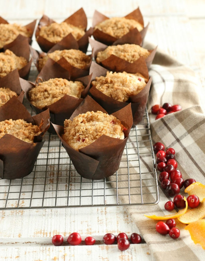 muffins in brown paper muffin cups cooling on baking rack