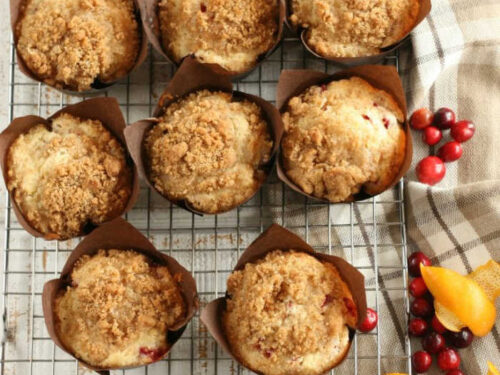 Cranberry Orange muffins with crumb topping in brown tulip style paper cupcake liners