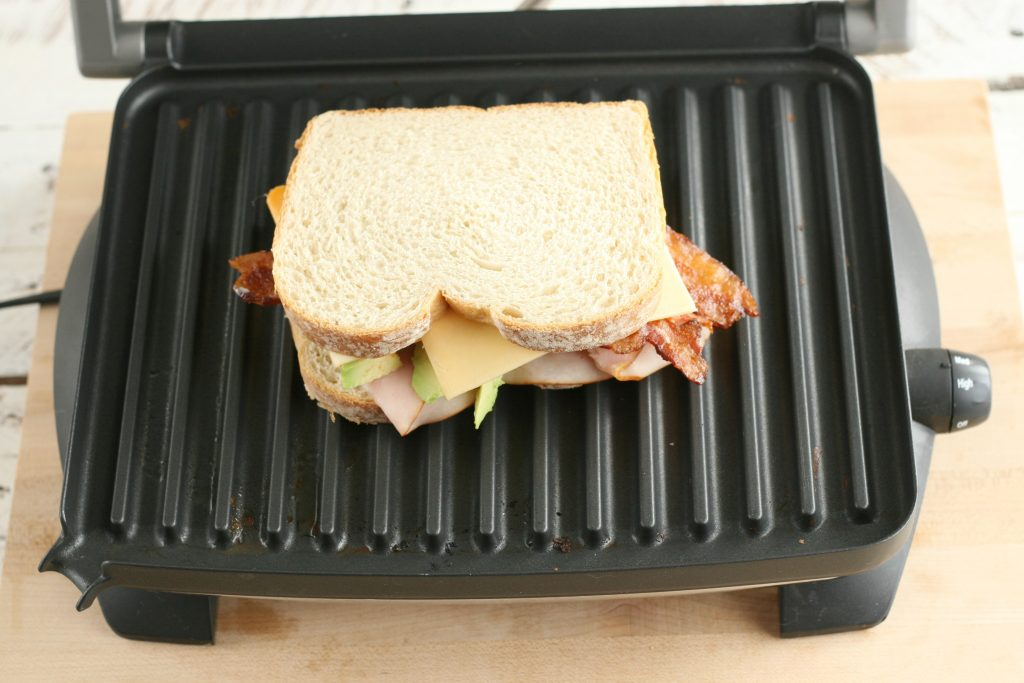 turkey bacon avocado panini on a panini press