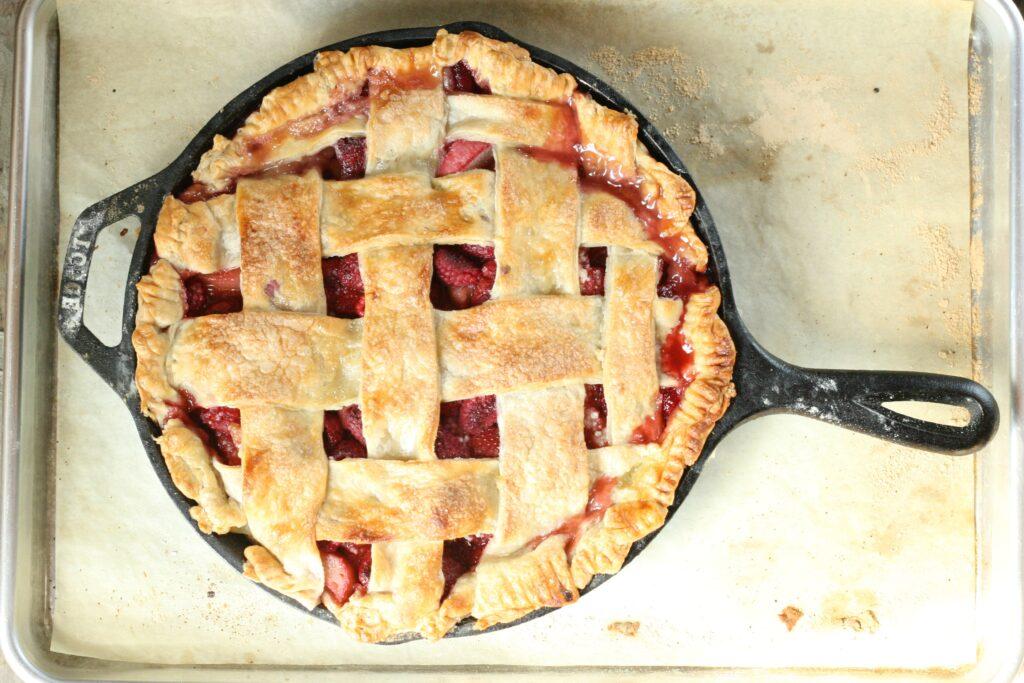Strawberry Raspberry Rhubarb Pie in cast iron skillet
