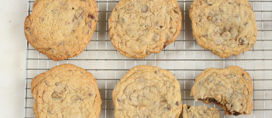 Perfected Chocolate Chip cookies cooling on a baking rack