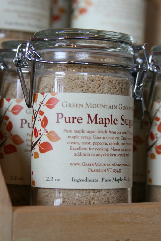 granulated maple sugar in small glass jars