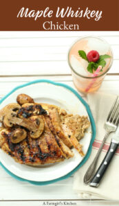maple whiskey grilled chicken on plate with a glass of strawberry lemonade