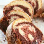 red velvet bundt cake slices on white footed cake dish