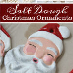Hand painted Santa faces salt dough ornaments drying on cardboard