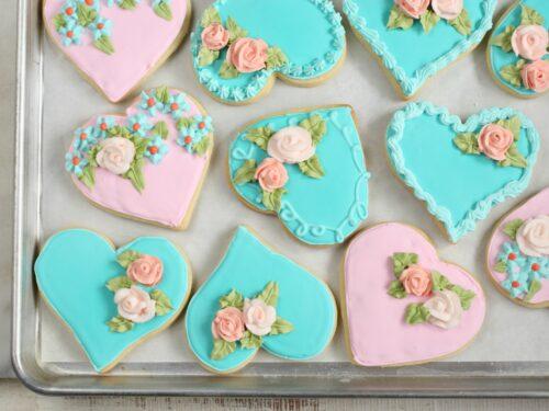 Heart shaped sugar cookies with handmade sugar roses
