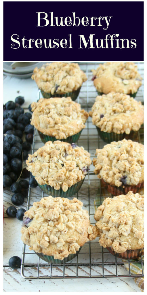 Homemade blueberry muffins with a streusel topping siting on a baking rack cooling