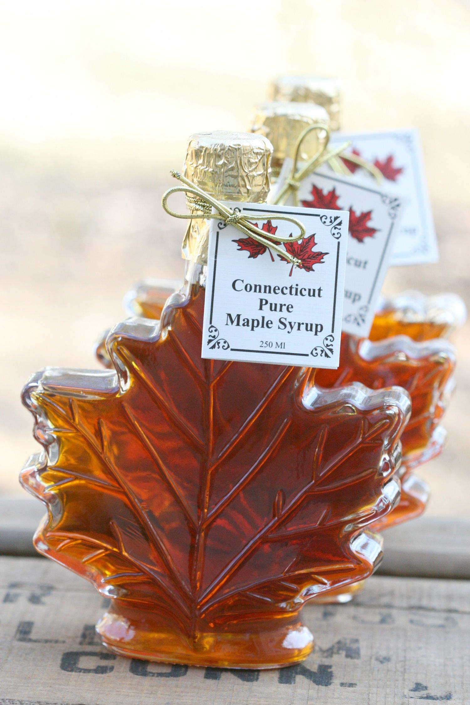 Pure maple syrup in Italian glass maple leaf containers.