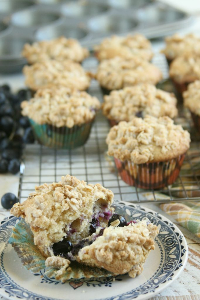 Rustic Blueberry muffins sitting on vintage plate