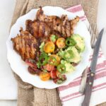 Southwestern grilled chicken thighs with avocado tomato salad