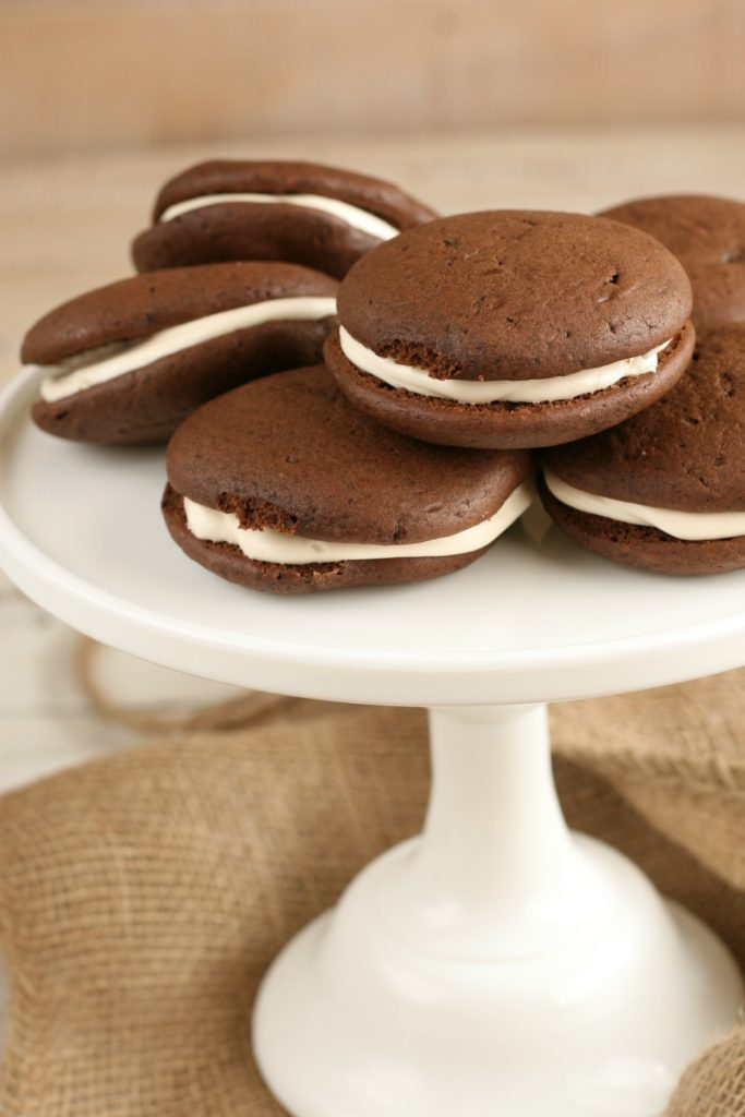 homemade chocolate whoopie pies on a footed cake dish