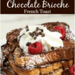 Chocolate Brioche French Toast stacked on white plate with whipped cream, chocolate, and fresh raspberries