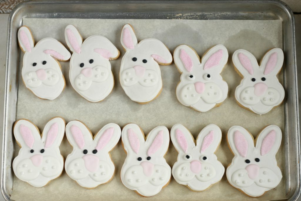 Easter bunny decorated sugar cookies on sheet pan