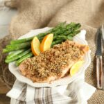 maple pecan crusted salmon with asparagus and orange slices on burlap