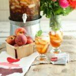 Fresh brewed peach sweet tea in glasses with fresh mint