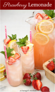 Homemade strawberry lemonade in glasses and pouring pitcher
