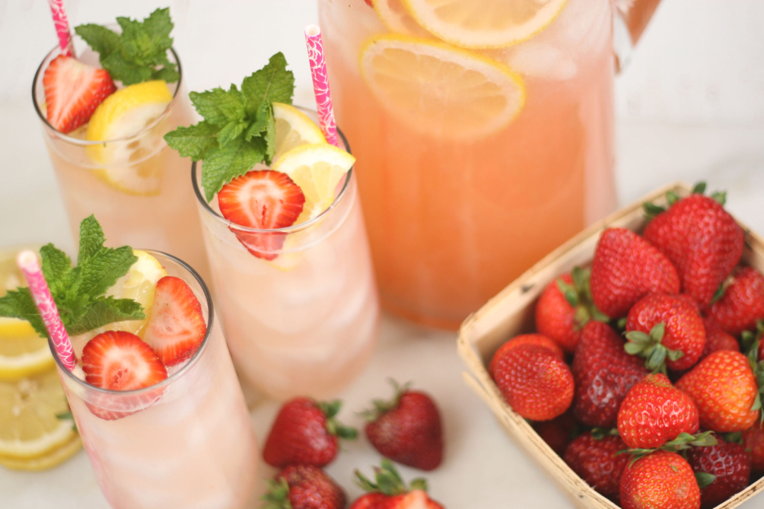 glasses of homemade strawberry lemonade.