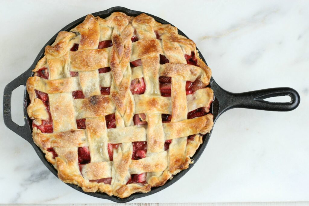 trawberry Rhubarb Pie with lattice crust in a cast iron skillet