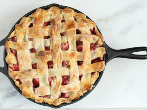 Make this delicious homemade Strawberry Rhubarb Pie with lattice crust. #recipe #strawberryrhubarb #pie #castironrecipes #strawberries