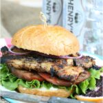grilled chicken on roll with leaf lettuce and heirloom tomato slice