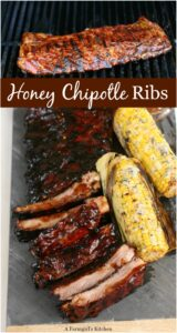 grilled ribs basted with barbecue sauce and grilled corn on the cob