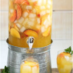 white wine sangria in glass pouring pitcher