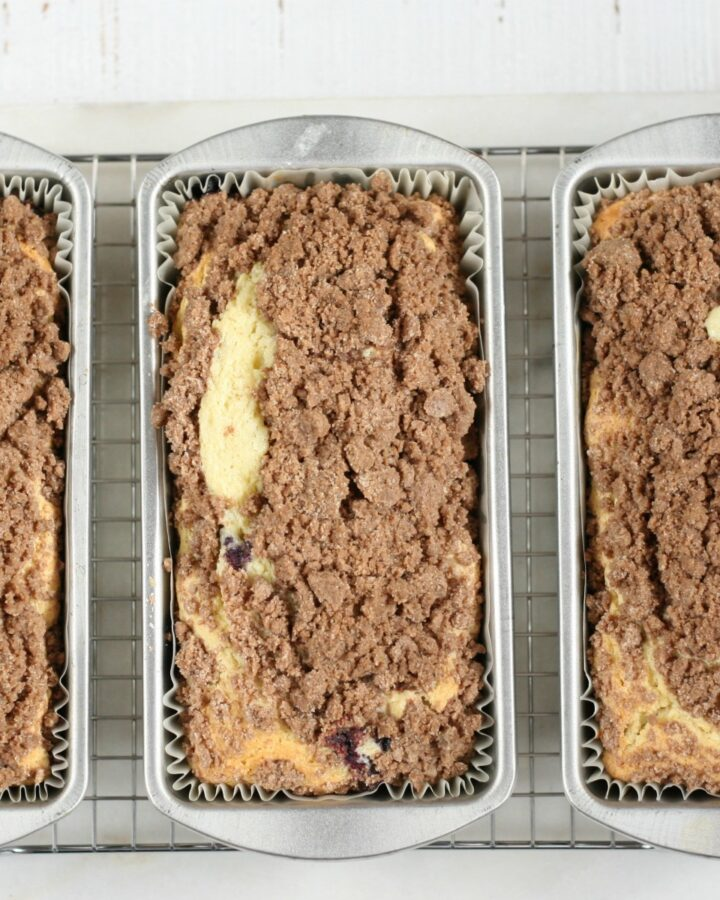 Coffee cakes with streusel topping cooling on a baking rack