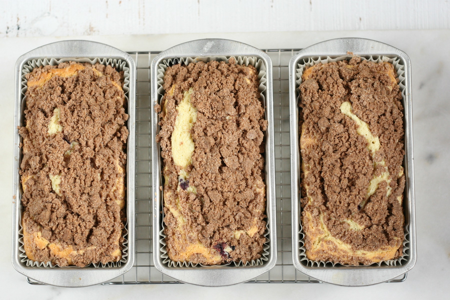 Blueberry Coffee cakes with streusel topping cooling on a baking rack.