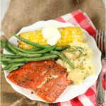 grilled salmon with corn on the cob, fresh green beans, and mashed potatoes