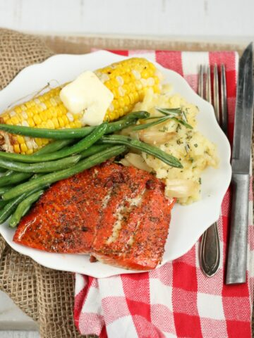 Maple Bacon wild salmon with corn on the cobb, fresh green beans and roasted garlic mashed potatoes