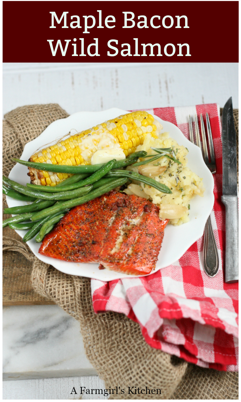 Maple Bacon Wild Salmon is grilled over charcoal on a wooden plank, wonderfully moist and flavorful.  Get the #recipe #grilling #grilledsalmon #salmon #easyrecipes