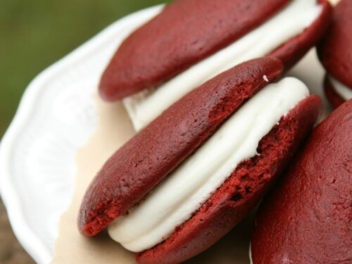 Red Whoopie Pies on a footed cake dish