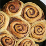 homemade cinnamon rolls in a 17-inch cast iron pan
