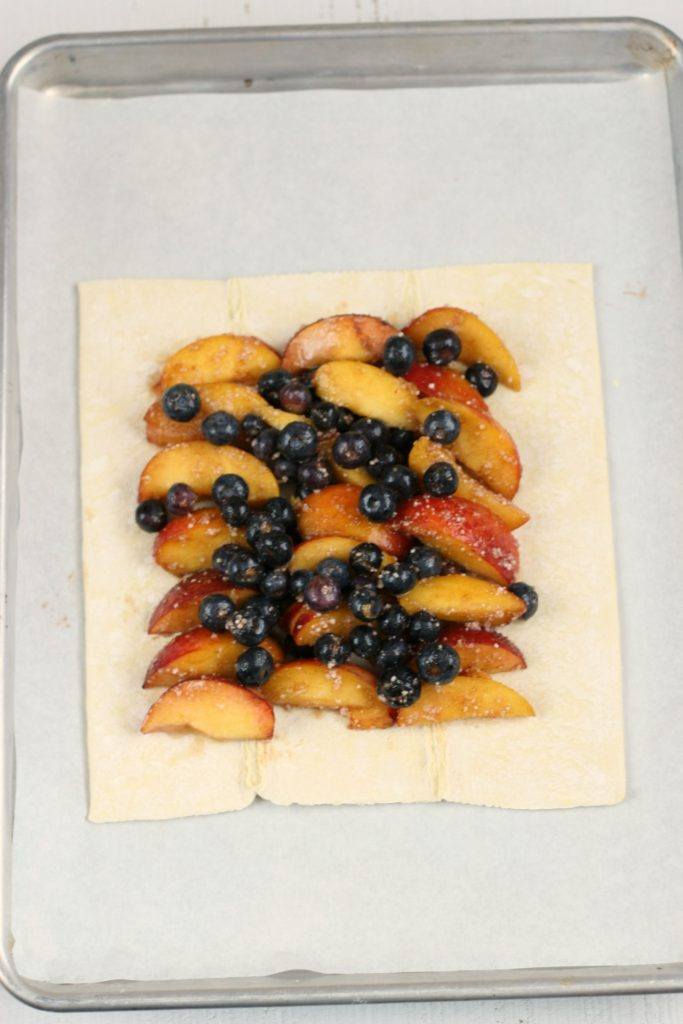 unbaked puff pastry with blueberries and peaches