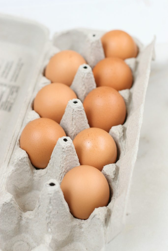 brown eggs in a paper carton