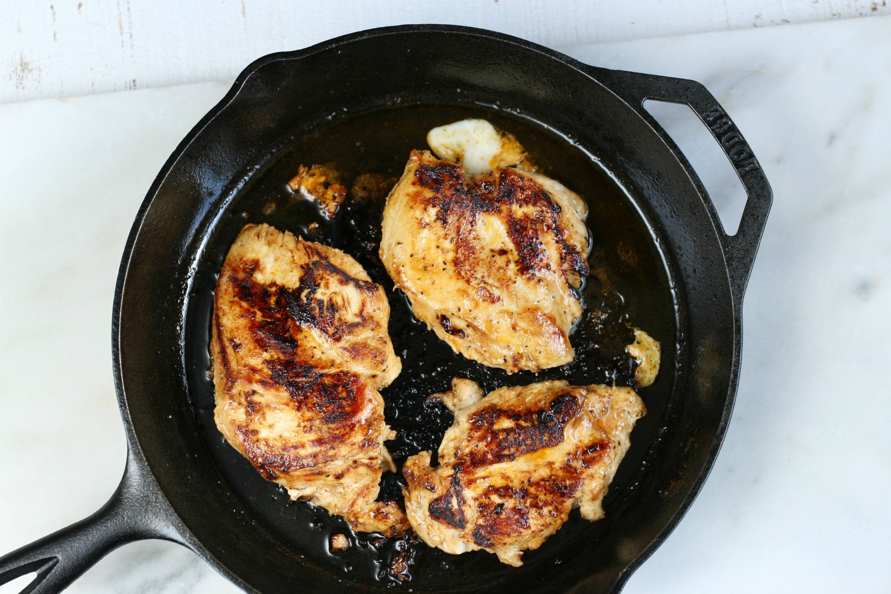 grilled chicken in cast iron skillet.