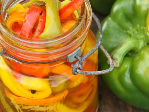 Sweet pickled Peppers in vintage Mason Jars on reclaimed wood boards