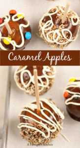 caramel and chocolate apples on a sheet pan
