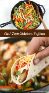 chicken fajitas with grilled onions and peppers in a cast iron skillet